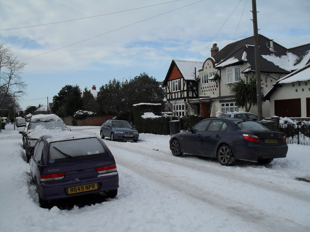 Approaching the junction of  a snowy Grove Road and Town Hall Road