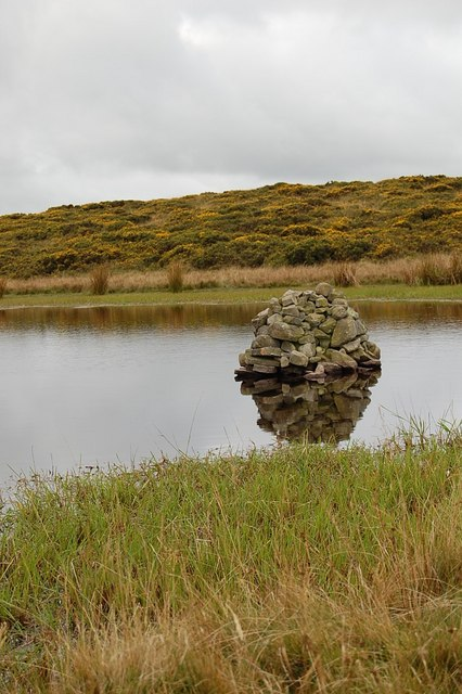 Cairn in pond