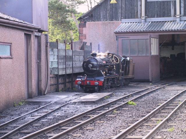 Miniature steam engine outside engine sheds