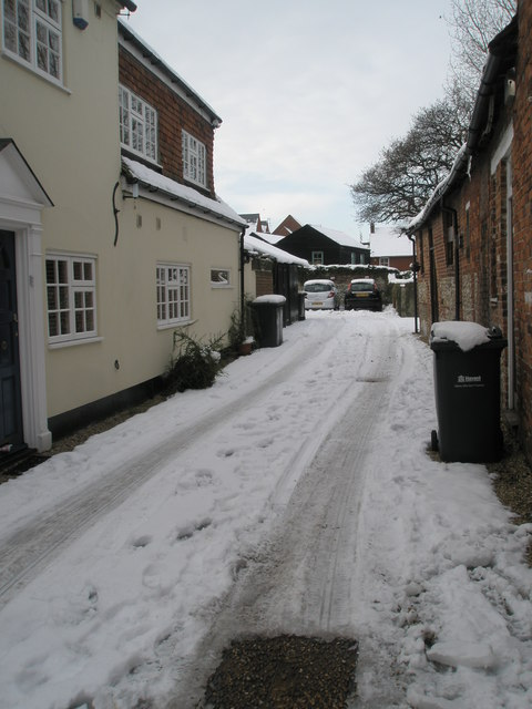 "A snowy access road next to ""The Old House at Home"""