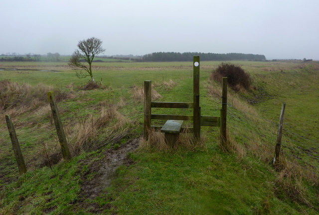 Stile on embankment footpath
