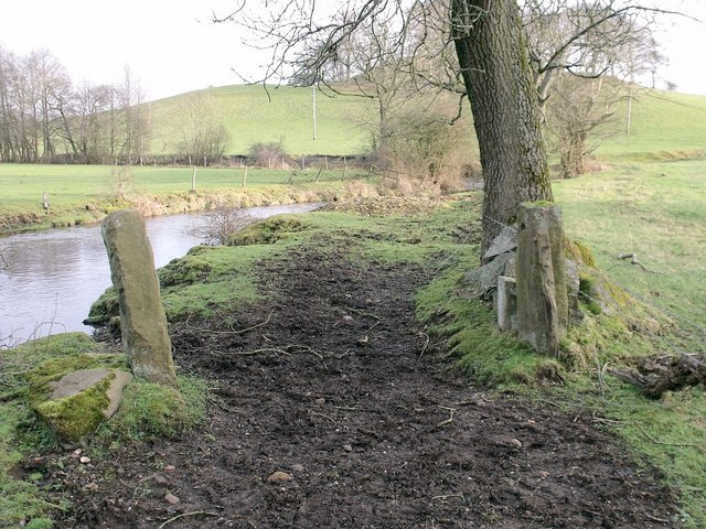 Old field gate by a river