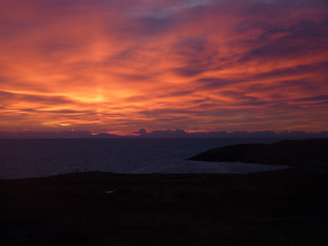 Sunrise over the Minch highlighting the mainland hills