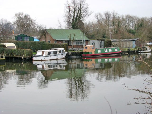 Boats moored by holiday homes on the River Yare