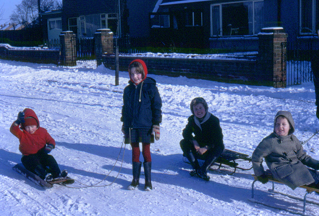 Children sledging in the street, 1969