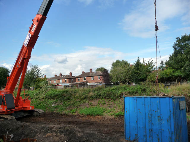 Crane on disused railway line north west of Chorlton Junction