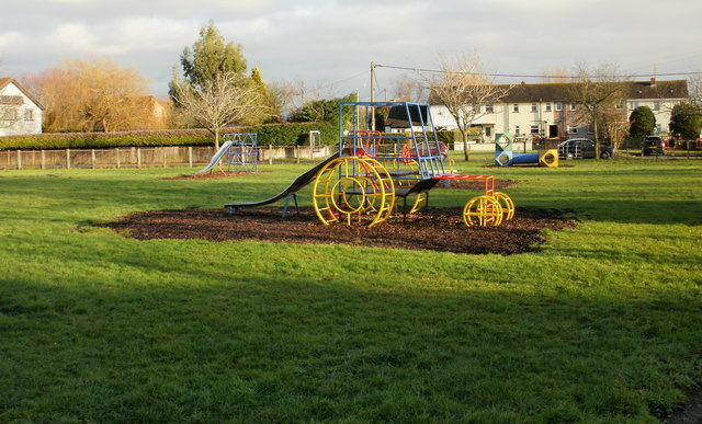 Tractor-shaped climbing frame in children's play area, Nash