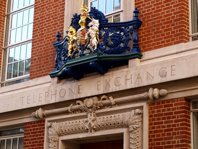 Fine casting and moulding above the door of the old Telephone Exchange in Sedding Street