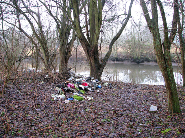 Flytip by the river