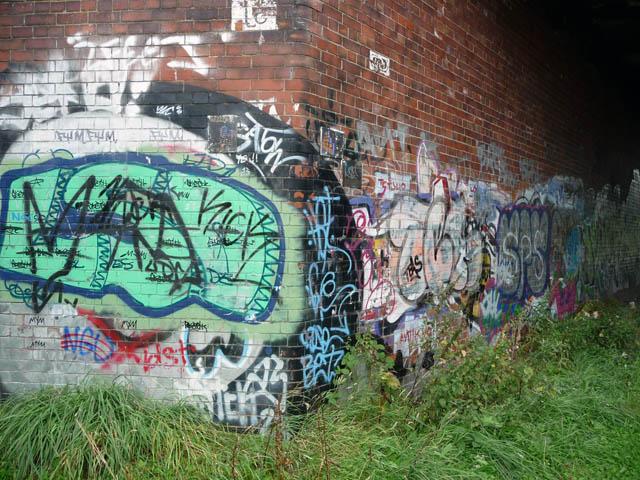 Graffiti beneath southern span of St Werburgh's Road railway bridge