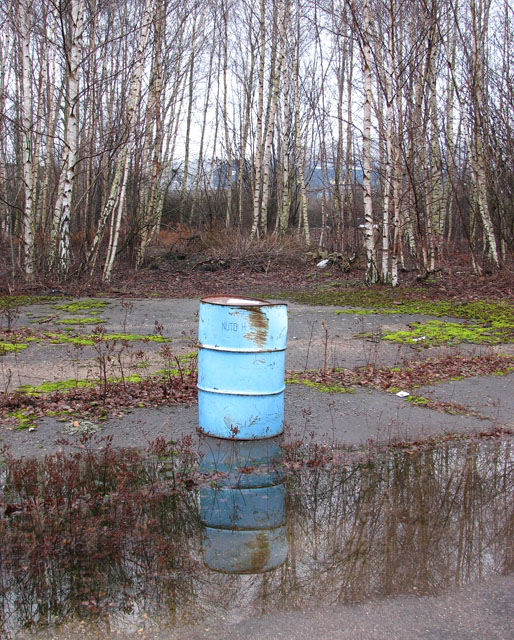 The Deal Ground - oil drum reflected in puddle