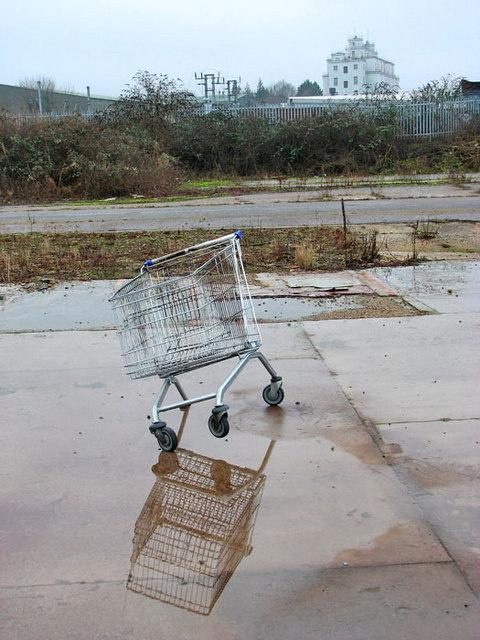 Shopping trolley missing a wheel