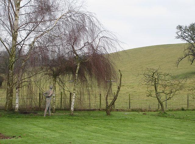 Naked figure strolls through winter garden