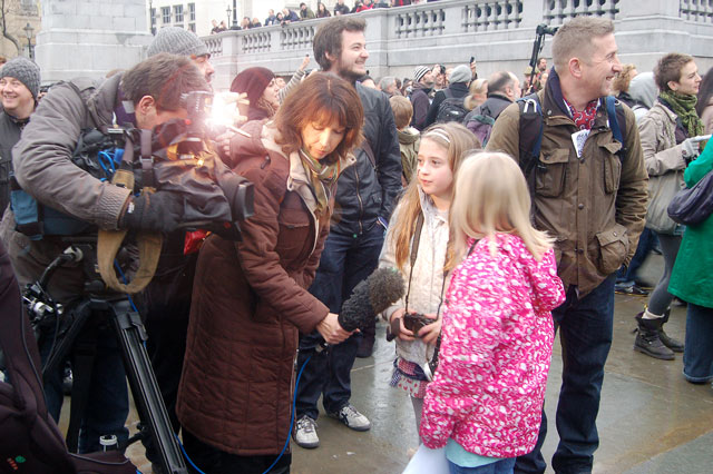 ITV crew interviewing young protester at mass photo gathering