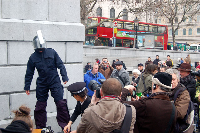 Mock 'terrorism officers' at a mass protest in Trafalgar Square