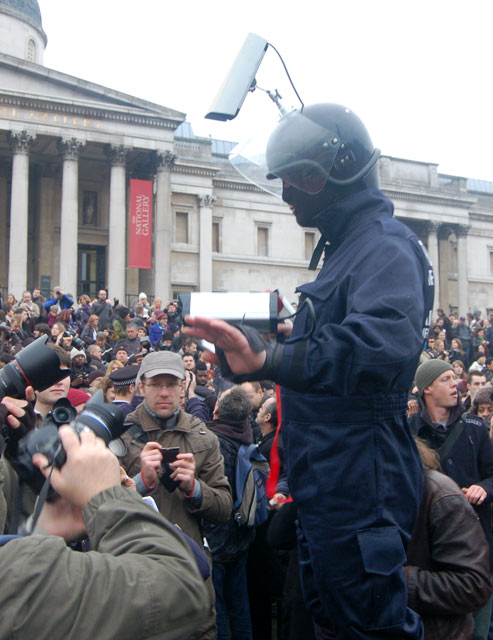 Mock 'terrorism officer' entertaining protesters in Trafalgar Square