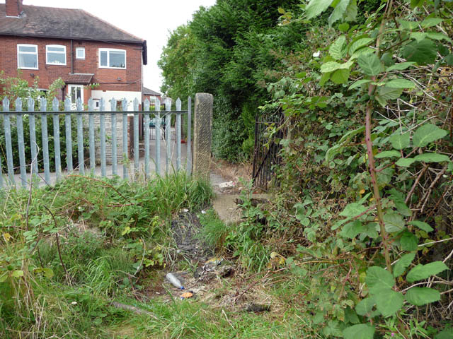 Gate leading to access road behind shops on Egerton Road South