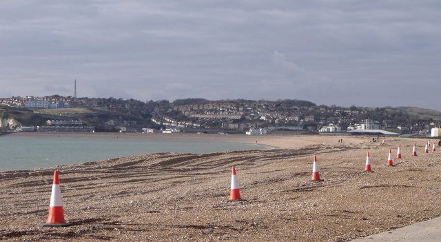 A row of traffic cones on the beach at Bishopstone, East Sussex