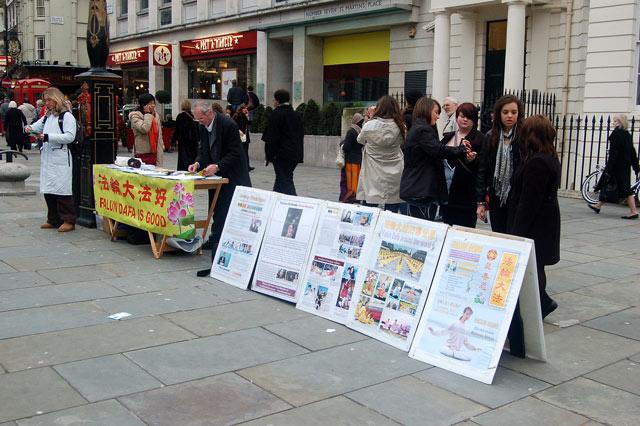 Falun Gong (aka Falun Dafa) display in St Martins Place WC2