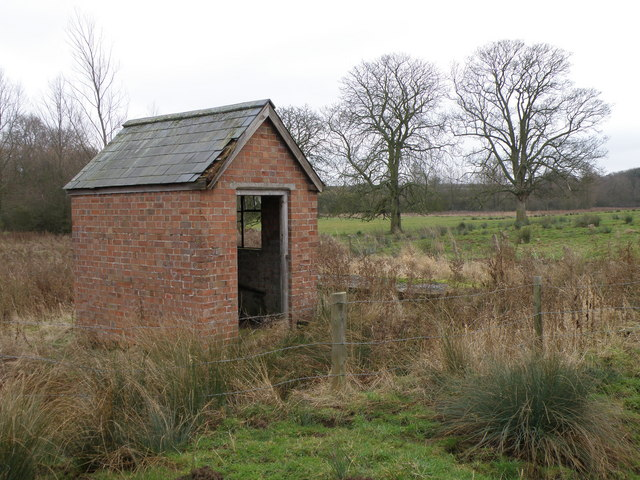 Brick shed by the footpath