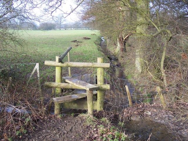 Stile and footbridge near Little Odiam