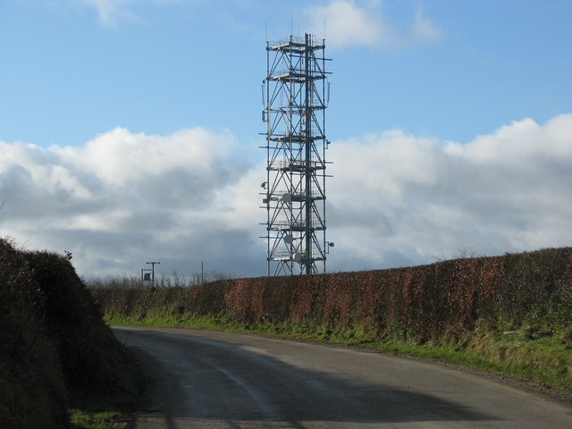 Communications mast above the road at Venhay Cross