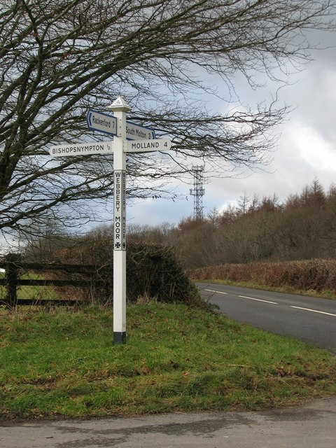 Communications mast above the road at Webbery Moor Cross