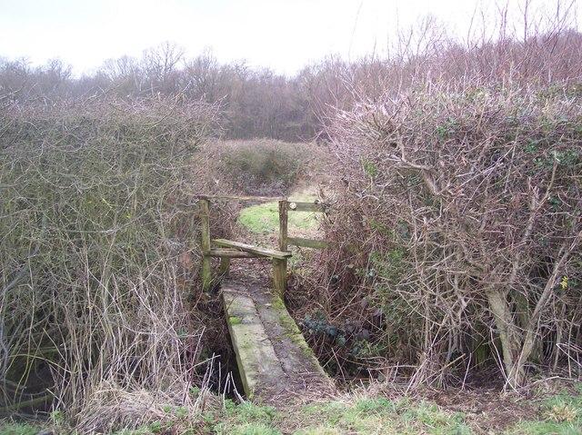 Footbridge and stile near Purchase Wood