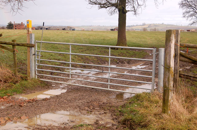 Bridleway gate with Calcutt House Farm in the distance