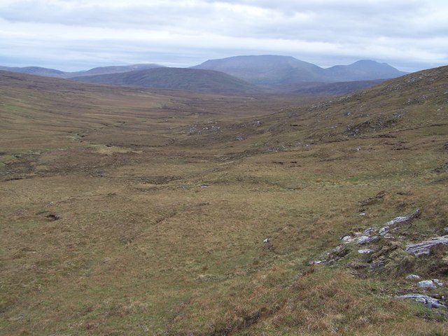The broad valley of Allt na Creige Riabhaich, looking SE towards the peaks of Beinn Spionnaidh and Cranstackie in the distance..