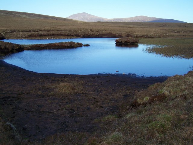 Peat-water lochan on SW bealach of Meall an Fhuarain.