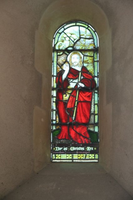 Window behind the altar