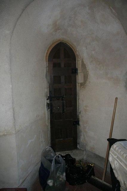 Narrow door near the font