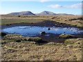 NC5922 : A peaty lochan - the source of the River Brora. by Nick Lindsay