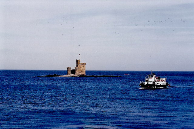 Douglas Bay - Tower of Refuge and passing tour boat