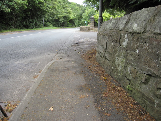 Roadside wall and a bench mark