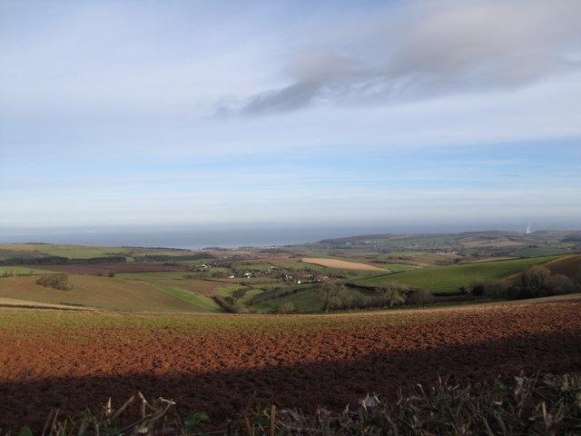 Red, muddy field on a Somerset hillside