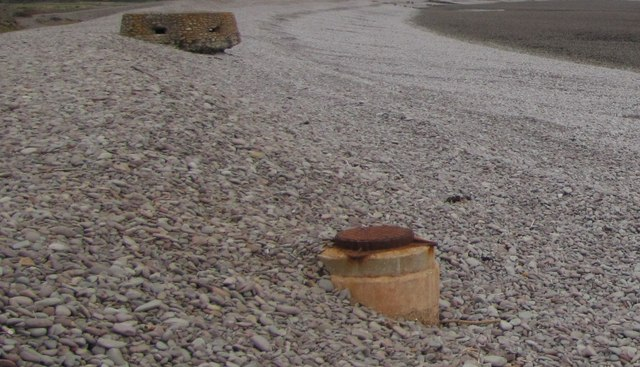 Manhole cover & Pillbox on the beach