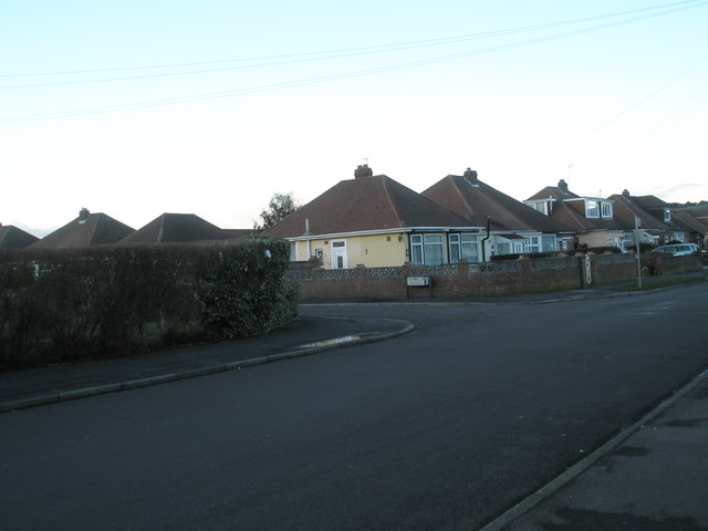 Approaching the junction of   Denville Avenue and Bayly Avenue