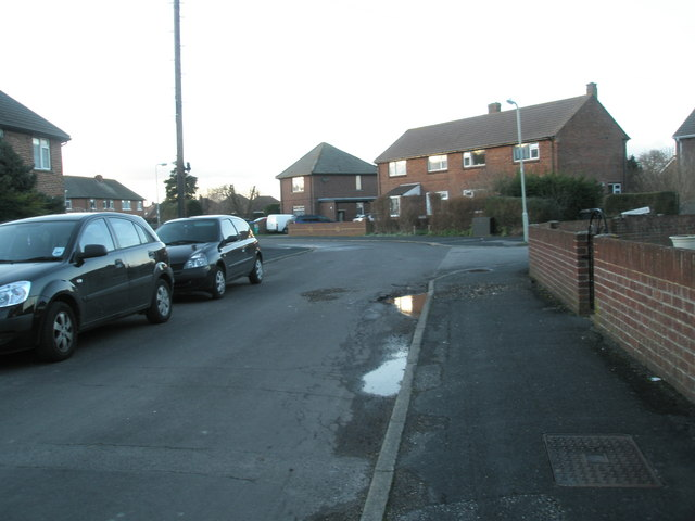 Approaching the junction of   Norman Close and Castle view Road