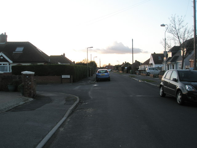 Approaching the junction of  Roman Grove and Lansdown Avenue
