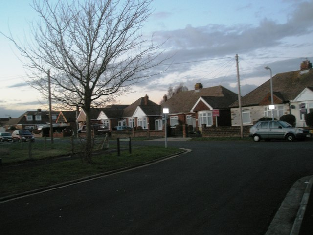 Approaching the junction of   Carberry Drive and Norgett Way