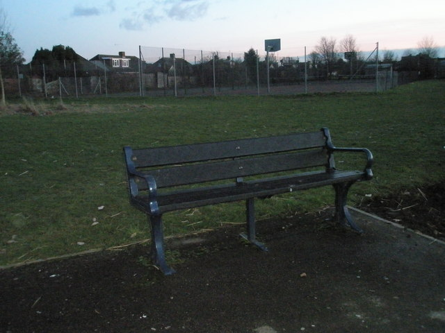 Seat in front of the basketball court at Portchester Park