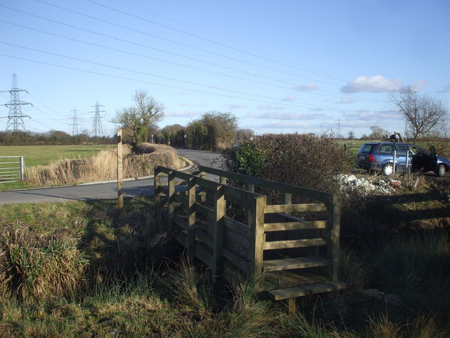 Stile and footbridge near Whitson