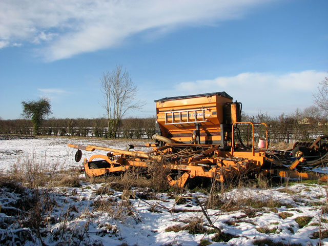 Seed drill parked at field's edge