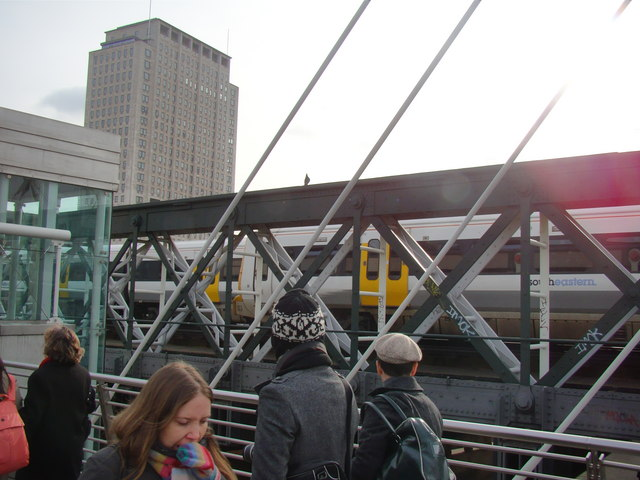 Two trains pass on Charing Cross Bridge