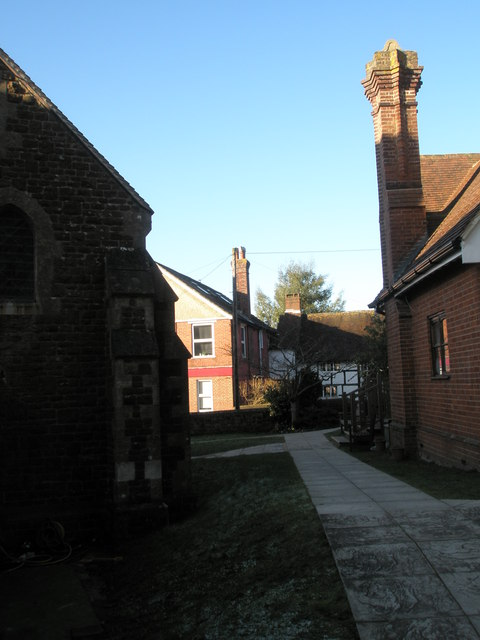 Looking between St Stephen's, Shottermill  and the church hall into Churt Road