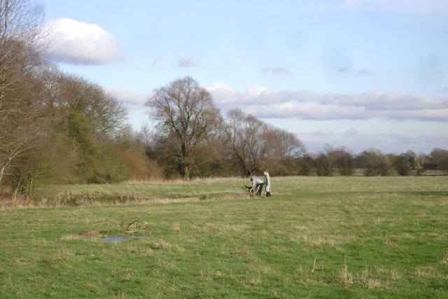 Couple and dog in a field by the Leam