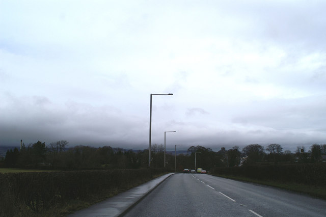 The view along the A671, the former A59, with Clitheroe Castle right of centre