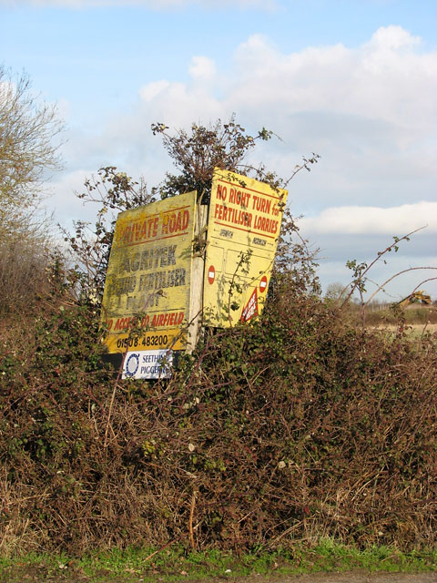 A sign in the hedge